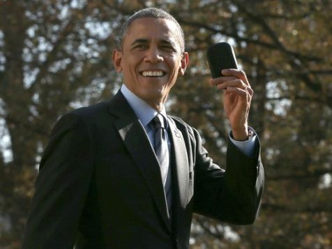President Obama holds up his Blackberry