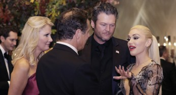 Entertainers Gwen Stefani and Blake Shelton speak to New York Gov. Andrew Cuomo.   Getty