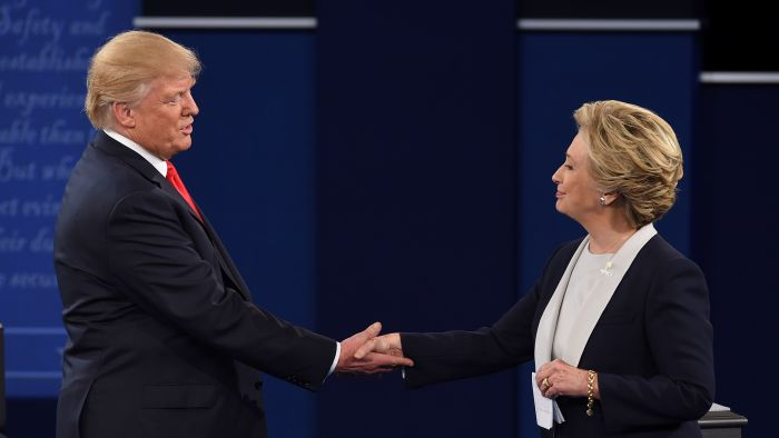 Democratic presidential candidate Hillary Clinton and Republican presidential candidate Donald Trump shake hands at the end of the second presidential debate at Washington University in St. Louis, Mo., onSunday, October 9, 2016 | Getty Images