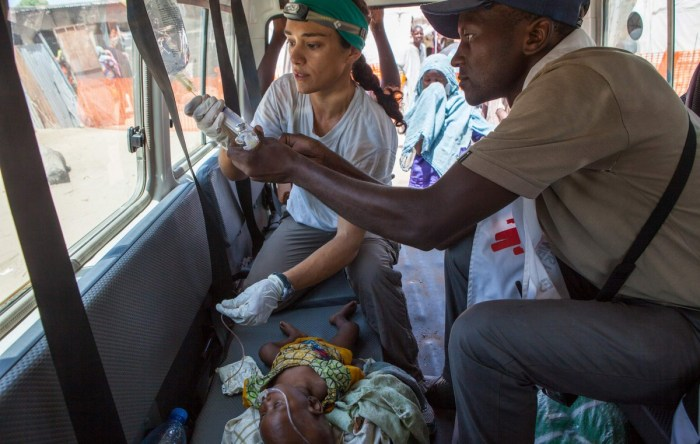 Physician Belen Ramirez Bourdages and nurse Thomas Ngoune treat Fana Ali at a clinic in Banki, Nigeria, on Sept. 28. The six-month-old girl weighed 12 pounds. | The Washington Post