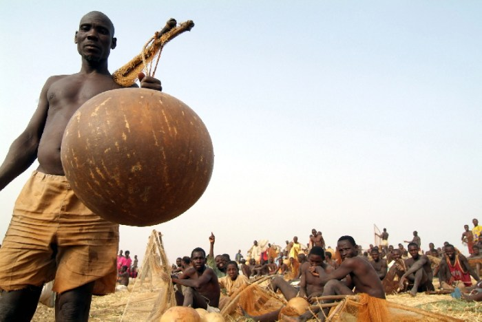 George Osodi took his lenses to the Argungu Fishing Festival. A man is pictured with a fish pot   The New Gong