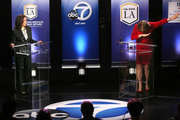 State Atty. Gen. Kamala Harris watches as rival Rep. Loretta Sanchez strikes a pose after her closing statement at their debate at Cal State L.A. on Wednesday, October 7, 2016 | Rick Loomis/ Los Angeles Times