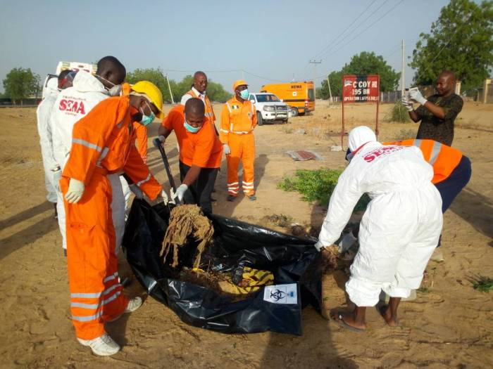 The bodies of female suicide bombers evacuated from military outpost in Borno by NEMA officials | PR Nigeria