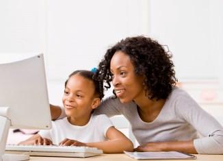 education Mother daughter girl homework internet laptop