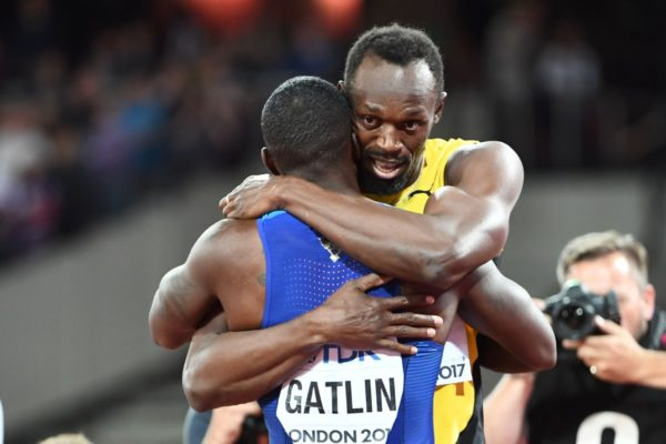 Usain Bolt embraces Gatlin, who takes the gold