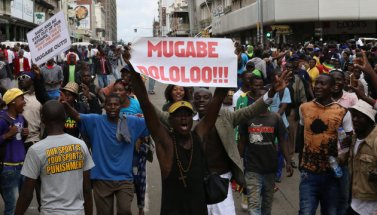 Protesters calling for Zimbabwean President Robert Mugabe to step down take to the streets in Harare, Zimbabwe November 18, 2017. REUTERS/Philimon Bulawayo