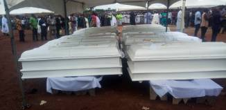 Caskets of the 2 Roman Catholic priests and 17 parishioners murdered by Fulani herdsmen in Benue on Tuesday, May 22, 2018 in Makurdi as they are given a mass burial| Twitter