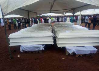Fulani Caskets of the 2 Roman Catholic priests and 17 parishioners murdered by Fulani herdsmen in Benue on Tuesday, May 22, 2018 in Makurdi as they are given a mass burial| Twitter