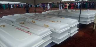Christians Boko Haram Deadlier Caskets of the 2 Roman Catholic priests and 17 parishioners murdered by Fulani herdsmen in Benue on Tuesday, May 22, 2018 in Makurdi as they are given a mass burial| Twitter