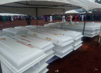 Boko Haram Deadlier Caskets of the 2 Roman Catholic priests and 17 parishioners murdered by Fulani herdsmen in Benue on Tuesday, May 22, 2018 in Makurdi as they are given a mass burial| Twitter