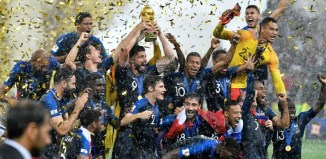 France's Olivier Giroud lifts the trophy after France won 4-2 during the final match between France and Croatia. AAP