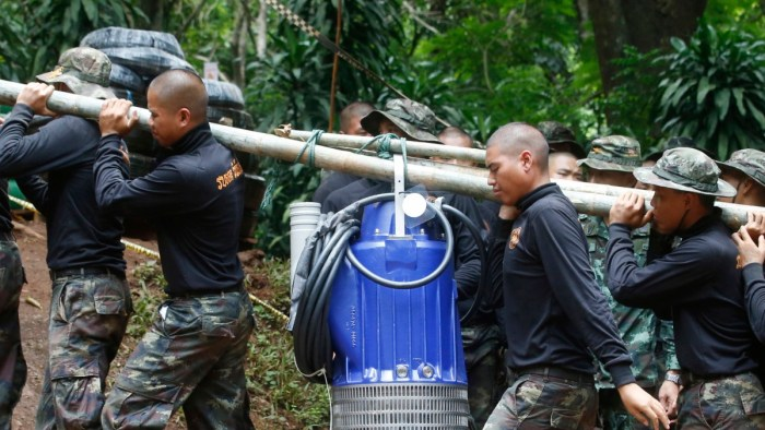 Thai rescue workers at the scene of the efforts to coach and 12 teenage football players trapped in a cave. | BT.com