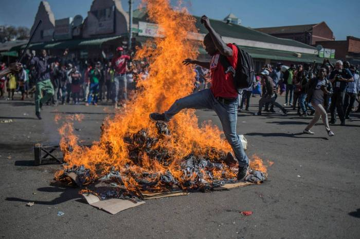 Opposition MDC party supporters protest in the streets of Harare during clashes with police AP
