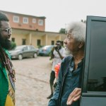 Onyeka Nwelue received Wole Soyinka as the Nobel laurent arrives at the venue of the film screening
