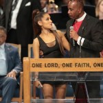 Ariana Grande with Bishop Charles Ellis III at Aretha Franklin's funeral on Friday, Aug 31, 2018 | Getty Images