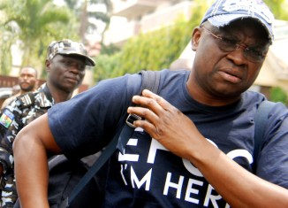 Ayodele Fayose, former Ekiti governor, arrives the Economic and Financial Crimes Commission (EFCC) office wearing a t-shirt with the inscription, 'EFCC, I Am Here' in Wuse, Abuja on Tuesday (16/10/18).   Anthony Alabi/NAN