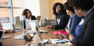 soft skills women woman laptop office tech meeting boardroom