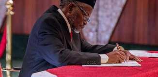 Newly sworn in acting Chief Justice of Nigeria, Ibrahim Tanko Mohammed and President Muhammadu Buhari