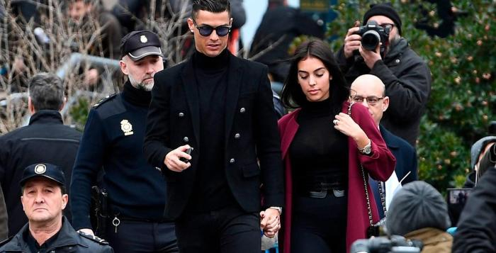 Cristiano Ronaldo leaves court following his hearing into tax fraud. AFP