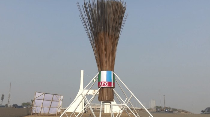 The gigantic APC broom erected at the Abuja City Gate in the Federal Capital Territory