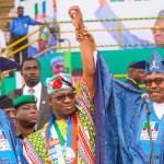 President Muhammadu Buhari (right) endorses Dapo Abiodun (centre) as the APC's Ogun governorship candidate, despite the public objection of Governor Ibikunle Amosun (left) [Ayodeji Ogunro]