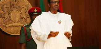 kidnappers President Muhammadu Buhari prays at a Federal Executive Council Meeting