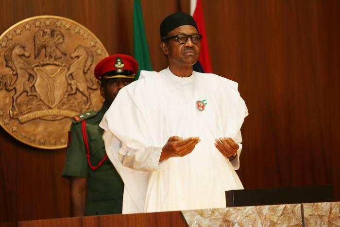 kidnappers President Muhammadu Buhari prays at a Federal Executive Council Meeting