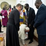Pope Francis kneels to kiss the feet of South Sudan's President Salva Kiir Mayardit, centre, and South Sudan opposition leader Riek Machar, right, in the Vatican.