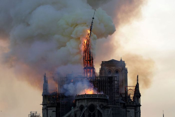 The steeple of the Notre Dame Cathedral in central Paris collapses on April 15, 2019. AFP/Getty Images