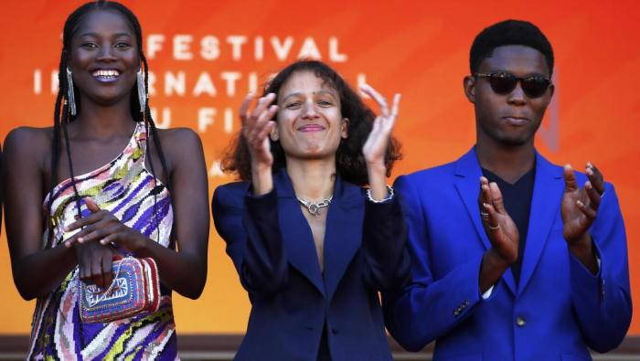 "Director Mati Diop (center) on May 16, 2019 in Cannes, where her film ""Atlantic"" is competing for the Palme d'Or."
