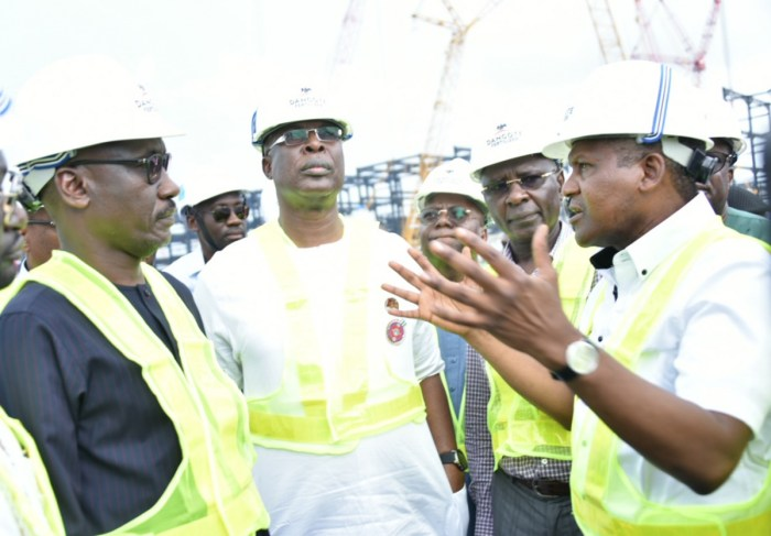 Group President/Chief Executive, Dangote Industries Limited, Aliko Dangote (right) stresses a point to MD, Nigerian National Petroleum Corporation (NNPC), Mallam Mele Kyari (left) and Timipre Sylva, Nigeria's minister of state for petroleum resources aft the Dangote Petroleum Refinery at the Petrochemical complex located at the Lekki Free Trade Zone in Lagos, Nigeria.