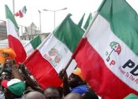 Party faithful fly PDP flags at a campaign rally.