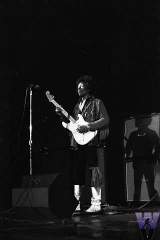 Hendrix sporting white boots at Woolsey Hall. Photo by Joe Sela, Courtesy of Wolfgang's Vault.