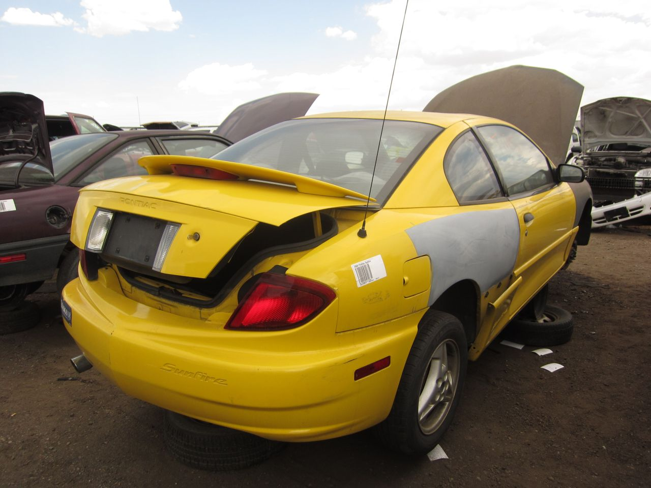 06 2004 pontiac sunfire down on the junkyard picture by murilee martin