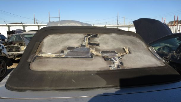 1996 BMW 328i E36 in California junkyard, convertible top damage - ©2016 Murilee Martin - The Truth About Cars