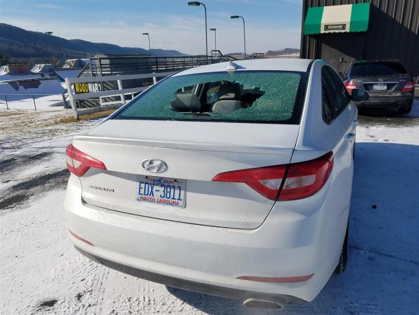 Hyundai Sonata Rental with broken rear window, Image: © 2017 Jack Baruth