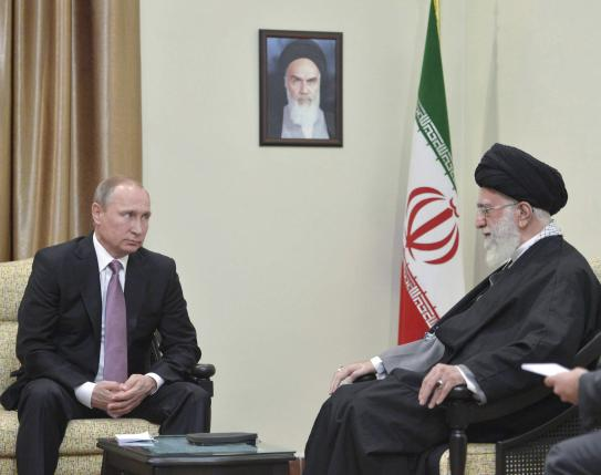 Russia's President Vladimir Putin (L), who arrived to attend the Gas Exporting Countries Forum (GECF), meets with Iran's Supreme Leader Ayatollah Ali Khamenei in Tehran, Iran, November 23, 2015.Alexei Druzhinin/Sputnik/Kremlin/File Photo via REUTERS