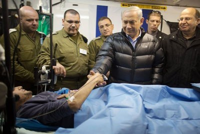 "The Israeli government has been providing medical assistance to wounded ""Syrian rebels"" for more than a year. In February, Prime Minister Benjamin Netanyahu visited to a military field hospital in the Golan Heights medical facility where wounded ""Syrian rebels"" were being treated. He is pictured here with Defence Minister Ya'alon."