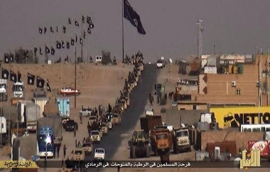 ISIS vehicles parade on the outskirts of Ramadi