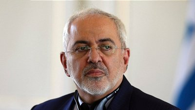 """In this Nov. 29, 2015, file photo, Iranian Foreign Minister Mohammad Javad Zarif listens to a question during a news conference with his Greek counterpart Nikos Kotzias in Tehran, Iran. Zarif said Thursday, Dec. 17 there """"seems to be no agreement"""" on two key issues just hours before the latest international conference on Syria was held Friday morning in New York."""