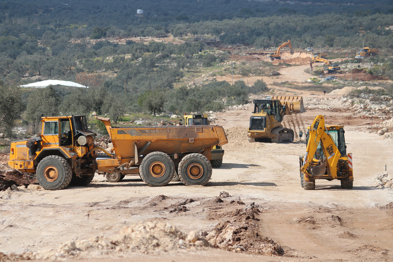 Israeli bulldozers work on a new Israeli settler road, in Nabi Elias village, in the occupied West Bank, on 6 February. Some 700 olive trees were uprooted from private Palestinian land to build the road. Click to enlarge