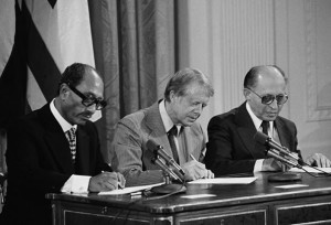 President Jimmy Carter signing the Camp David peace agreement with Egypt's Anwar Sadat and Israel's Menachem Begin. Click to enlarge