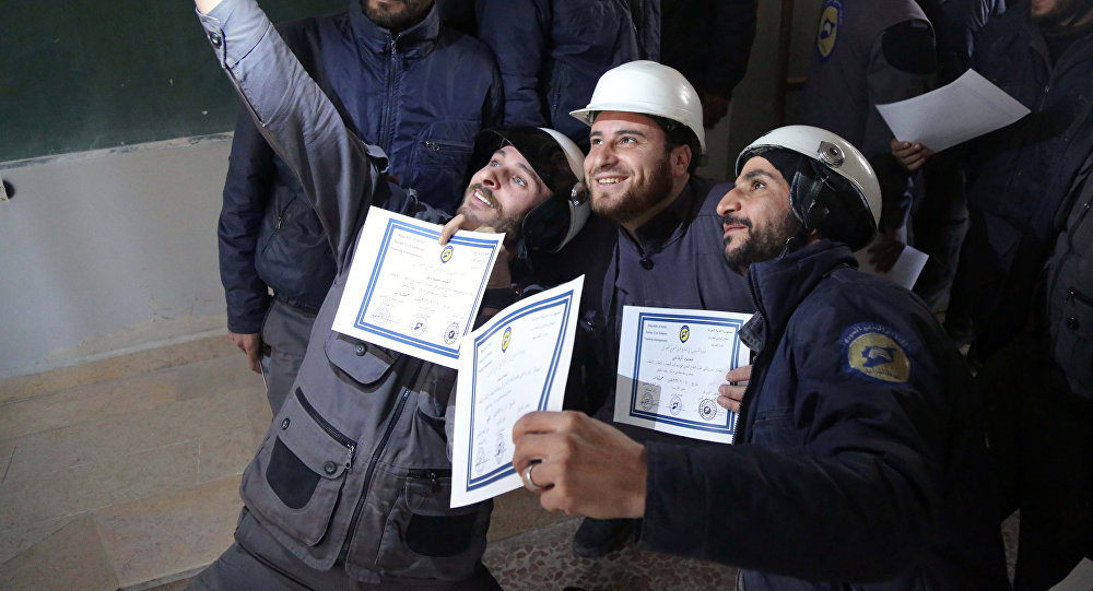 Syrian White Helmets pose for the press