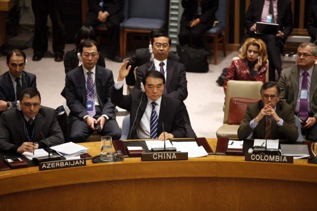 China's Ambassador Li Baodong (front C) votes during a U.N. Security Council meeting on a European-Arab draft resolution endorsing an Arab League plan calling for Syria's President Bashar al-Assad to give up power in New York February 4, 2012. The Homs attack made Friday the bloodiest day of an 11-month uprising and it gave new urgency to a push by the Arab League, the United States and Europe for a U.N. resolution calling for Assad to cede p+ower. Th Security Council had scheduled an open meeting for Saturday to vote on the draft. But Russia asked that the 15-nation body not immediately do so and instead hold consultations. REUTERS/Allison Joyce (UNITED STATES - Tags: POLITICS)