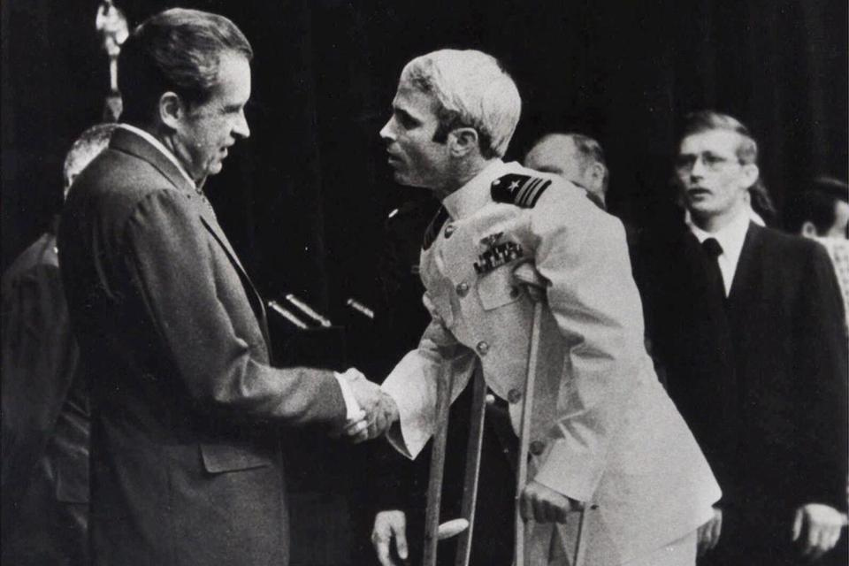 Former POW John McCain on Crutches, Greeting President Richard Nixon. Click to enlarge