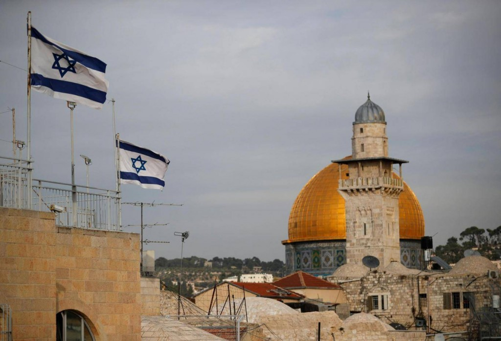 Israeli flags fly near the Dome of the Rock in the Al-Aqsa mosque compound in Jerusalem. Click to enlarge
