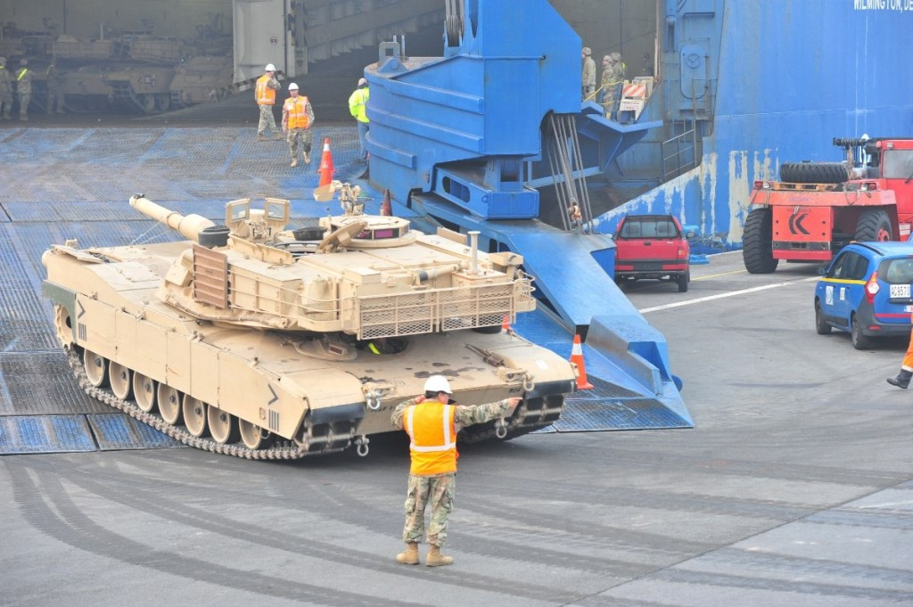 A U.S. Army soldier guides an M1 Abrams tank from 1st Armored Brigade Combat Team, 1st Cavalry Division off the ramp of the ARC vessel Endurance at the Port of Antwerp, Belgium. Click to enlarge