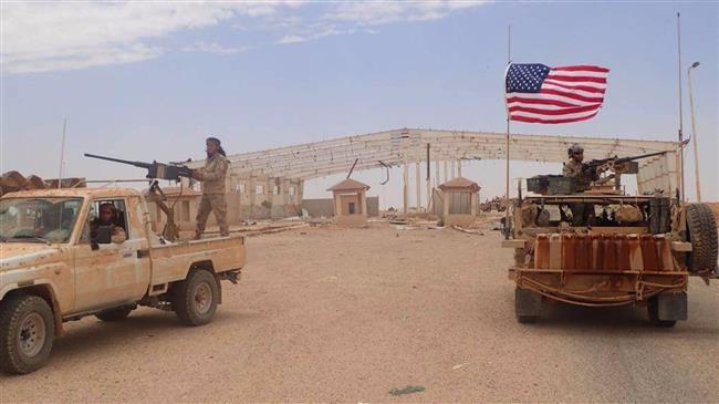 A US-backed Takfiri militant mans a heavy automatic machine gun (L) next to an American soldier as they take their positions at the al-Tanf border crossing between Syria and Iraq. Click to enlarge