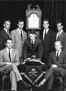 George H.W. Bush (to the left of the clock) Skull and Bones portrait