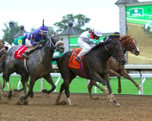 Fioretti holds off Heykittykittykitty (outside) and Judy the Beauty (inside) to win the Thoroughbred Club of America Stakes (gr. II) at Keeneland - Keeneland Photo
